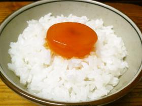 オレンジ鮮やか☆卵の黄身の醤油漬け by lizanana